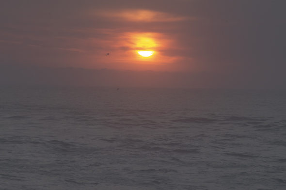 atlantic ocean coastline portugal sunset sun cloudy evening grey orange seascape